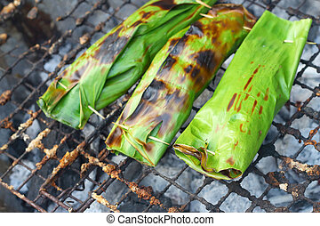 Sticky rice wrapped in banana leaves grill - Sticky rice...