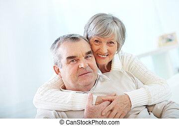 Loving spouses - Happy portrait of senior couple, woman...