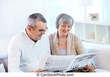 Reading together - Senior couple reading together fresh...