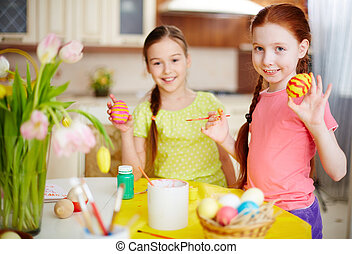 Funny Ester eggs - Two girls showing their painted Easter...