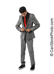 Indian man buttoning up his suit. - Asian Business man doing...