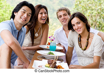 Friends On Vacation - A group of young adults having lunch...