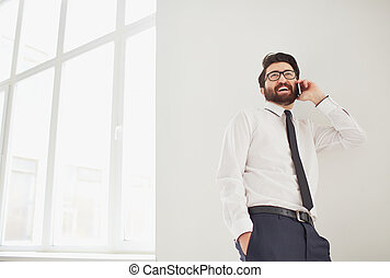 Calling - Portrait of elegant businessman speaking on...
