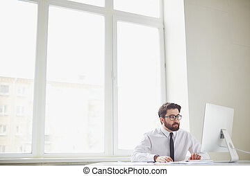 Busy office worker - Serious businessman sitting in office...