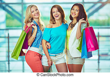 Company of shoppers - Portrait of three happy girls in smart...