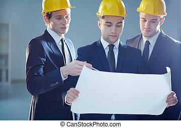 Constructors - Closeup image of three constructors...