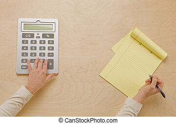 Calculate and Note Take - overhead shot of hand using...
