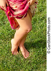 Sexy barefoot female legs - High angle view of a pair of...
