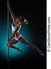 Graceful girl with neon makeup dancing on pilon - Graceful...