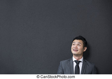 Chinese business man looking up. - Handsome Chinese business...