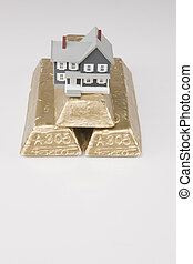 House on Gold - House sitting on top of Gold bars