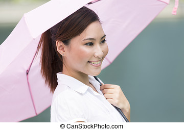 Young Asian business woman holding umbrella - Young Chinese...