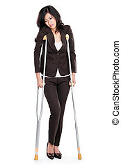 business woman with crutches