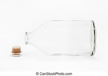 A lie down glass bottle in white background