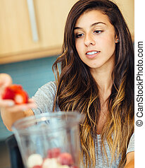 Woman with Fruit smoothie - Beautiful Young Woman Making...