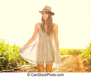 Gorgeous girl walking in the field, Summer Lifestyle -...