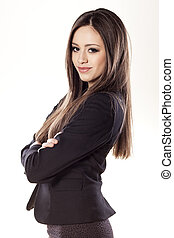 self confidence - young business woman posing with arms...