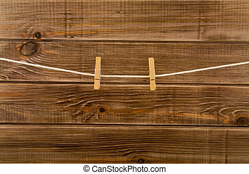 clothespins on a wooden background