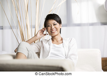 Happy Chinese woman talking on cell phone - Pretty Chinese...