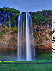 Seljalandfoss waterfall - Seljalandfoss waterfall at sunset,...