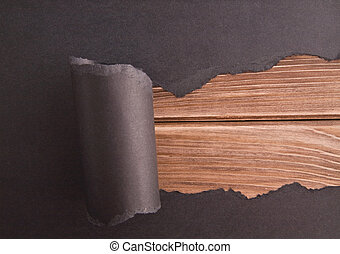 lacerated paper on a wooden background