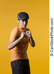 Portrait of Asian man throwing a punch
