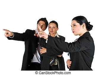 Business people pointing - Three business people at meeting...