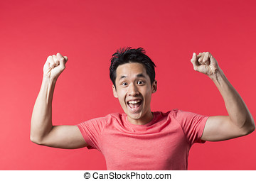Happy Chinese man celebrating - Cheerful Asian man...