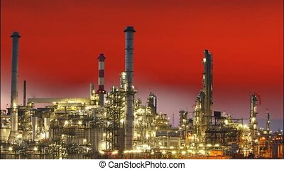 Oil refinery at sunset with sun - time lapse