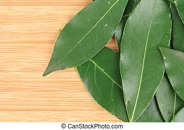 Bay leaves. On a cutting wooden board.