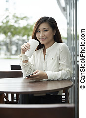 Portrait of an Asian office worker in a cafe - Portrait of a...