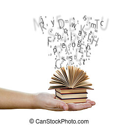 Education and knowledge concept - A hand holding books with...