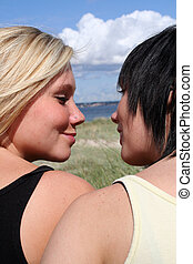 Two young women - Two Young women at the beach