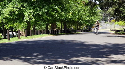 Woman on a bike ride in the park on a sunny day
