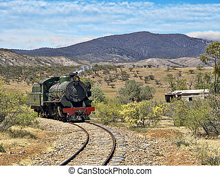 steam train coming around the corner