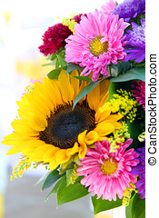 arrangement of summer flowers. sunflowers and aster