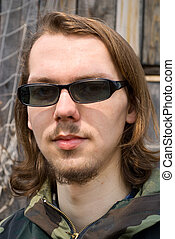 Young Man in Sunglasses 5 - A portrait close-up of the young...