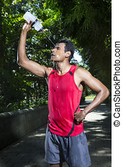 Indian man having a break from running - Indian man pouring...