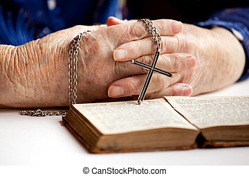 Hands with Cross - An elderly pair of hands holding a cross