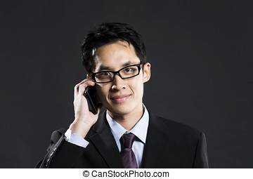 Chinesebusiness man using a smart phone. - Portrait of a...