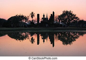 Ancient buddha statue. Sukhothai Historical Park, Sukhothai...