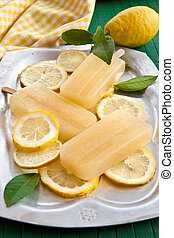 Fresh lemon popsicles on slices of organic lemons
