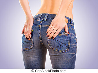 sexy woman buttocks in blue jeans on the blue - sexy woman...