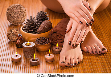 brown manicure and pedicure on the white - beautiful brown...