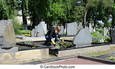 father grave plant flower - Woman girl daughter plant...