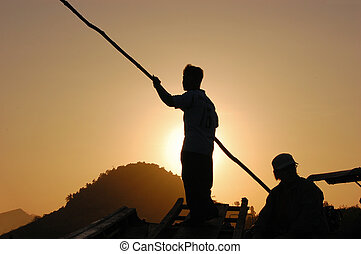 Silhouette of fishermen at sunrise