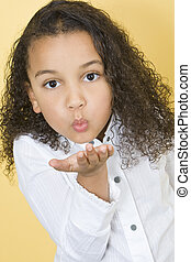 Blowing Kisses - Studio shot of a beautiful young mixed race...