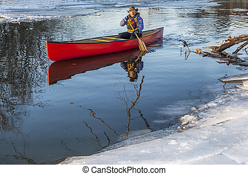 canoe paddling in winter