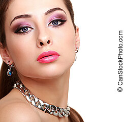 Beautiful sexy woman with bright eyes makeup isolated
