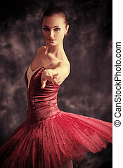 ballerina - Beautiful bellet dancer posing at studio over...
